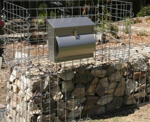 Letterbox attached to the upper gabion wall cage which is now ready to fill with sandstone pieces