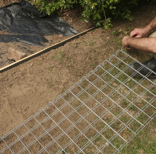 The spiral joiners wind easily through, to join the gabion cage mesh panels