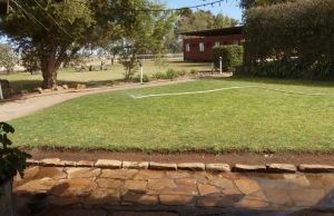 Sprinklers water lawns in arid zone gardens