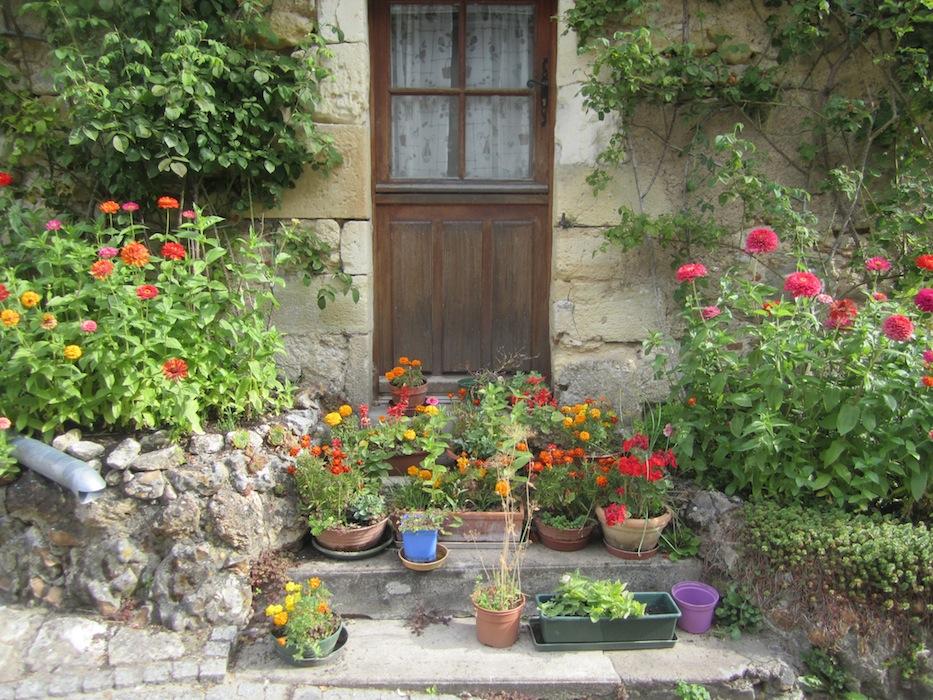 Flowers by doorways