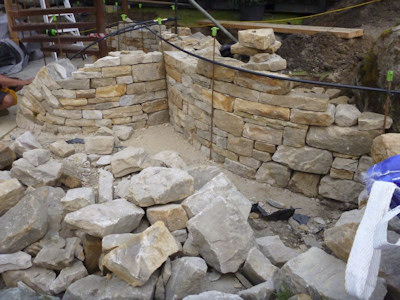 Stone wall building at the Chelsea Flower Show - this is not sustainable gardening