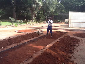 Digging out the red clay soil