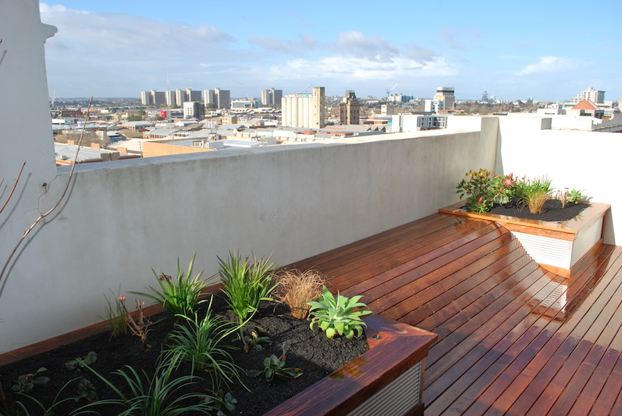 Decking wave for social lounging in a balcony garden - Design element
