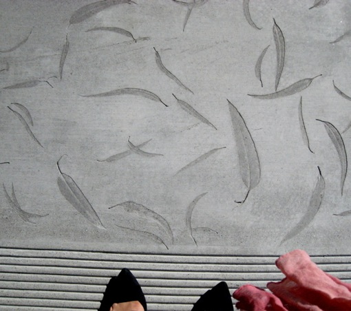 Leaf imprints in concrete