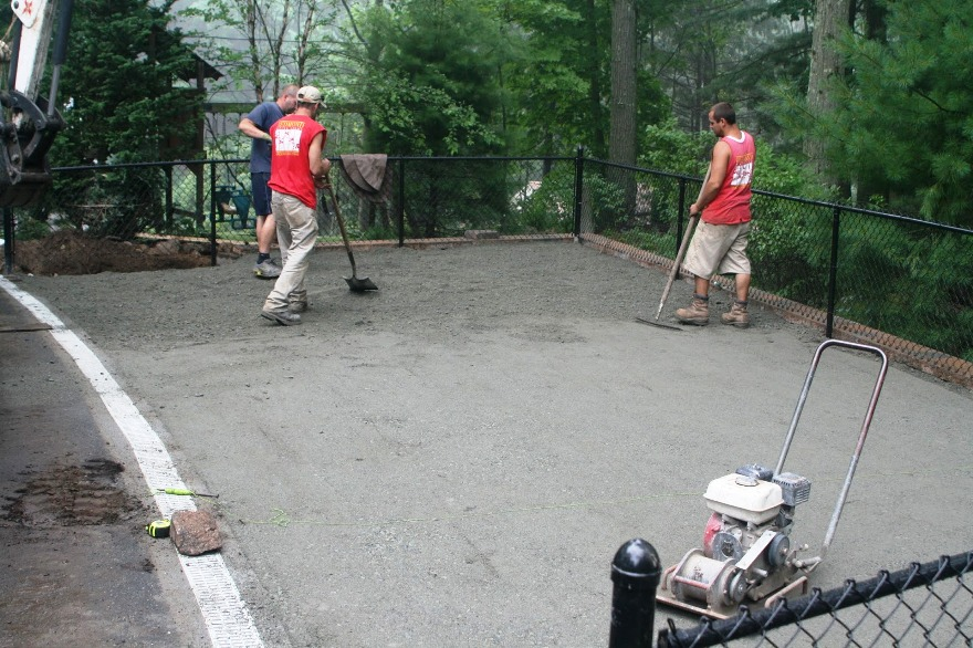 Redmond Design crew finishing the sub-surface preparation.  ©2013 BDG