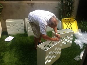 Putting together the vertical garden boxes