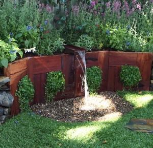 A Gardener's Garden - timber water rill and pebble soak