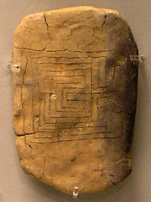 Reverse of a clay tablet from Pylos bearing the motif of the Labyrinth. The tablet, the earliest datable representation of the 7-course classical labyrinth, was recovered from the remains of the Mycenaean palace of Pylos, destroyed by fire ca 1200 BCE (Kern, Through the Labyrinth, Prestel, 2000, p. 73, catalog item 103–104). Note: there is no evidence for a connection between the labyrinth design and the legend of Theseus at this early date. (Photo credit: Wikipedia)