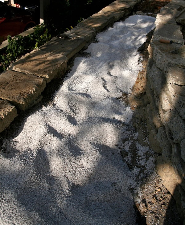 Improving clayey subsoil in a raised garden bed with perlite and vermiculite