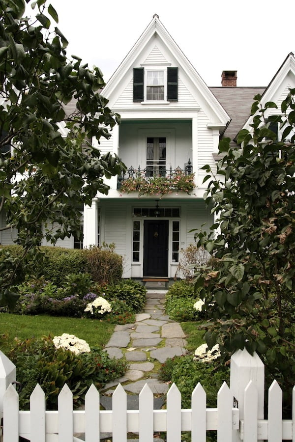 White timber house and picket fence