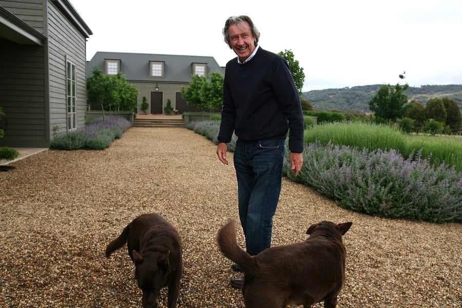Owner Bryan Gurry with kelpies Jack and Ruby, swathes of luxuriant purple Catmint and white Lavender in the background