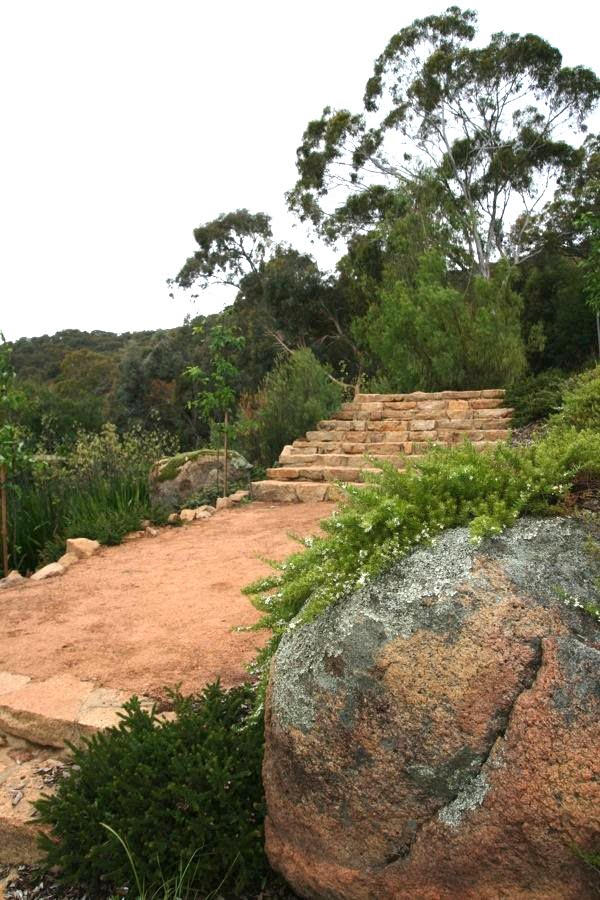 A grand crushed gravel pathway at The Falls using Australian natives and making use of views to established mature Eucalypts