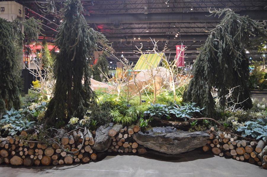 Garden edging formed with sticks and rocks. 'A Maleficent View' show garden. Design Leon Kluge. Philadelphia Flower Show 2015