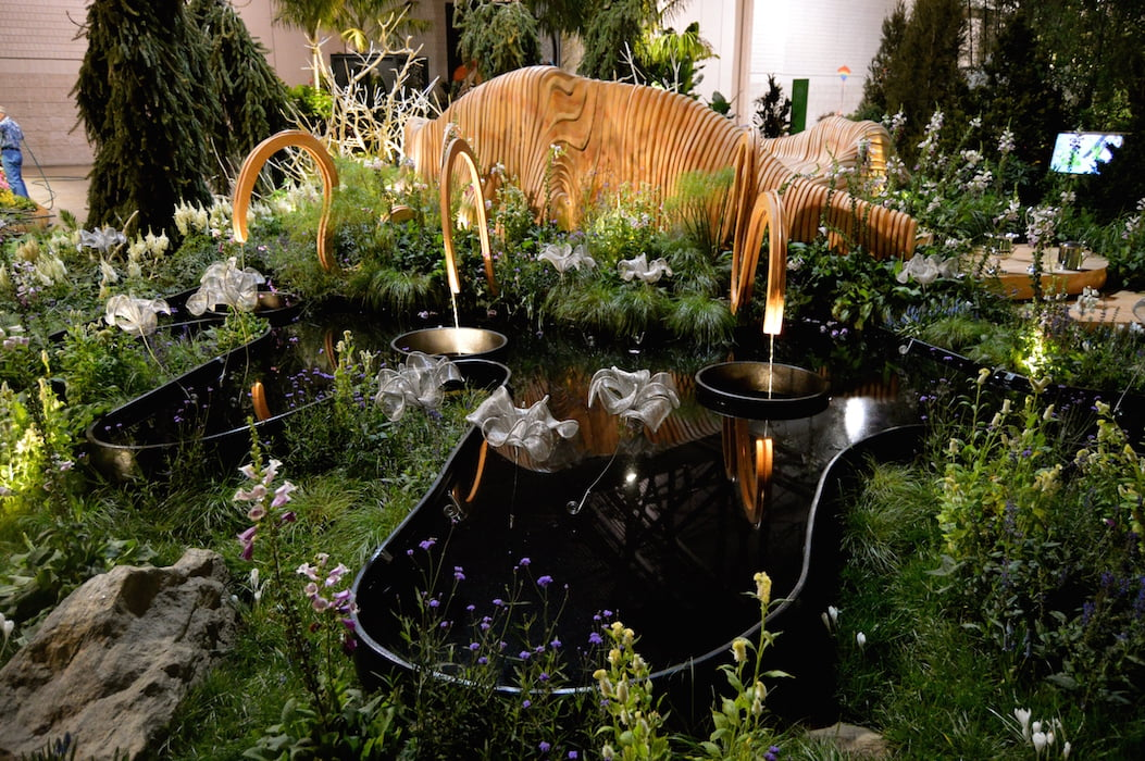 Organic shape and still black water in the reflection pond. A Maleficent View show garden. Design Leon Kluge