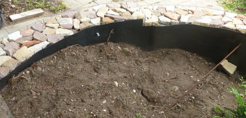 Tree root barrier behind the wall, conduit for lighting and deadman reo bar