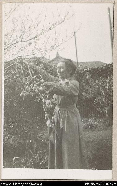 Ina Higgins in garden, Killena 1919. National Library of Australia