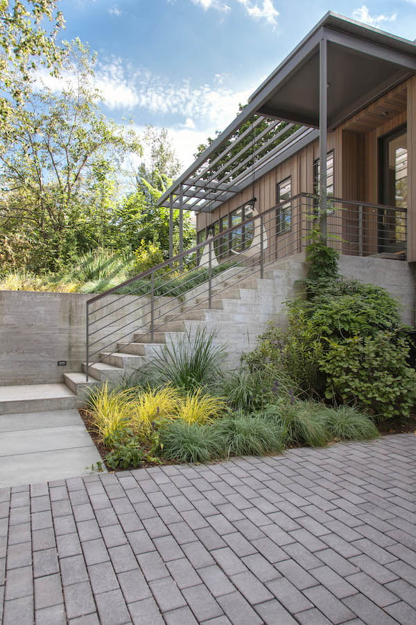 Textured board-formed concrete wall and permeable paving in the the new entrance Matthew Cunningham Landscape Design LLC Longwood garden