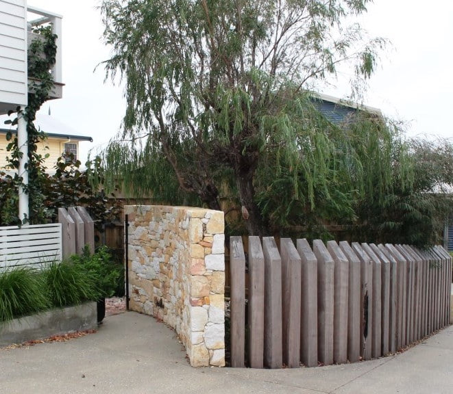 New curved Donnybrook stone entry wall and sleeper wall along drive