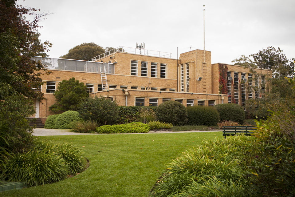 The vista from the heritage garden through the Gibson kidney shape beds to the administration building: photo Anne Vale