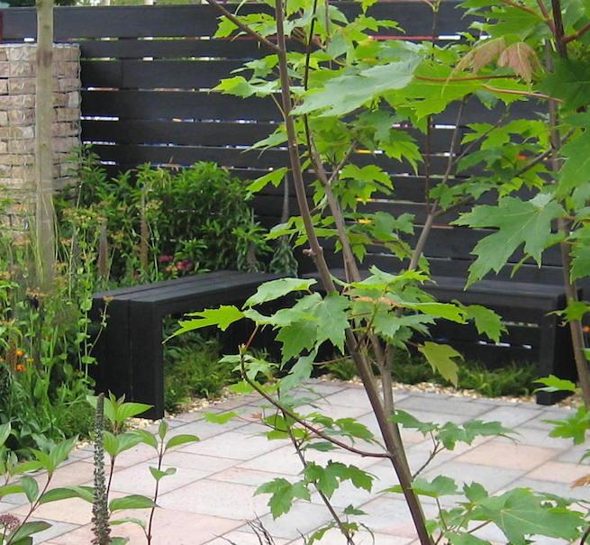 The black 'shou sugi ban' seats. Design Sid Stratton and Bridget Robinson. BBC Gardeners' World Live 2015
