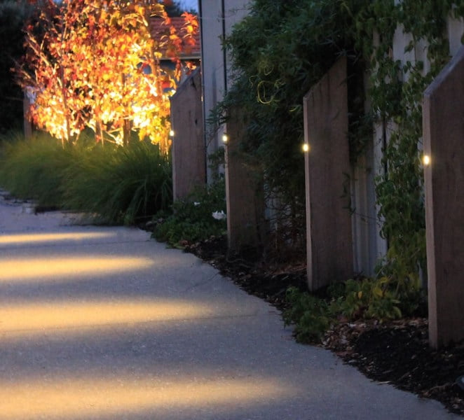 Welcoming vertical sleeper lights along the drive