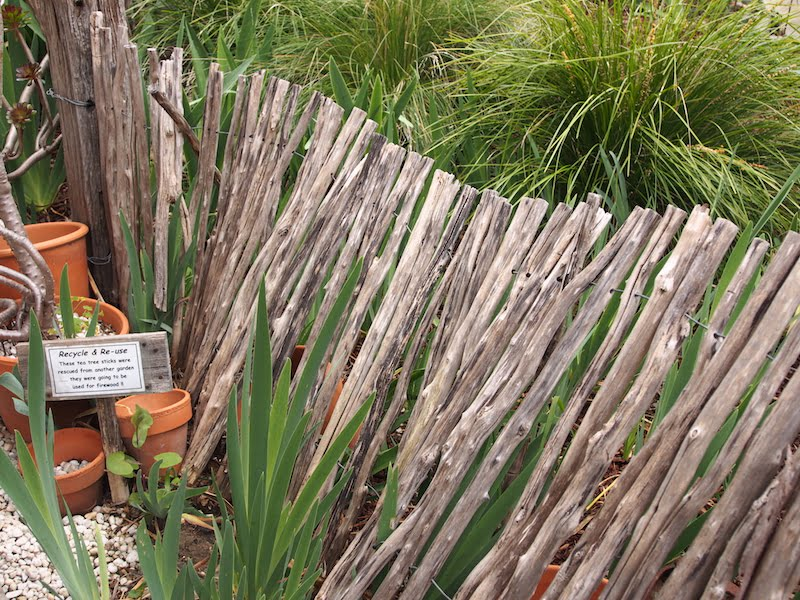 A recycled scrounged fence of old tea tree sticks destined for firewood