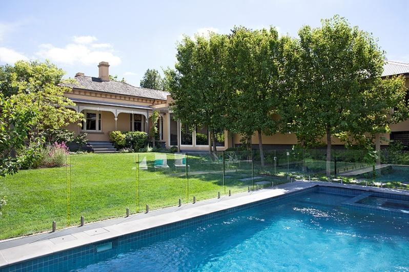 Pear trees provide shade and the pool is toward the back of the property. Design Ian Barker Gardens