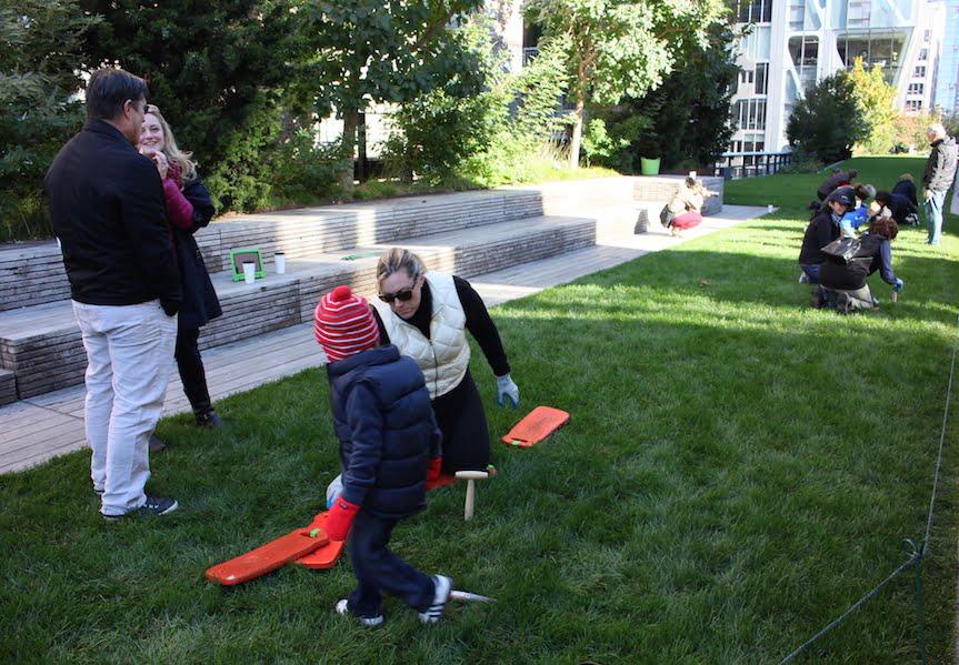 Volunteer planting of Crocus bulbs in the 23rd Street Lawn