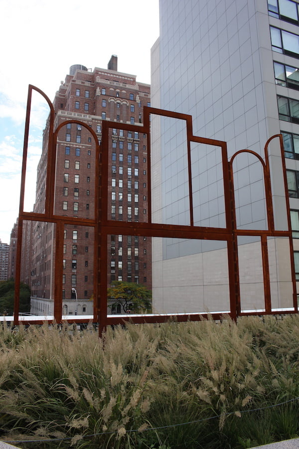 'Altar' by Chris Martin 2014 against the architecturally significant London Terrace Towers. High Line, NYC