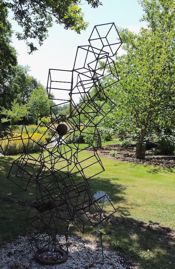 Contemporary sculpture compliments the landscape in the Jardin du Bois du Puits