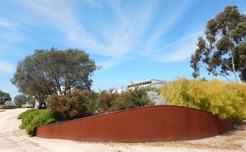 Using Cor-ten steel retaining walls to build up garden beds