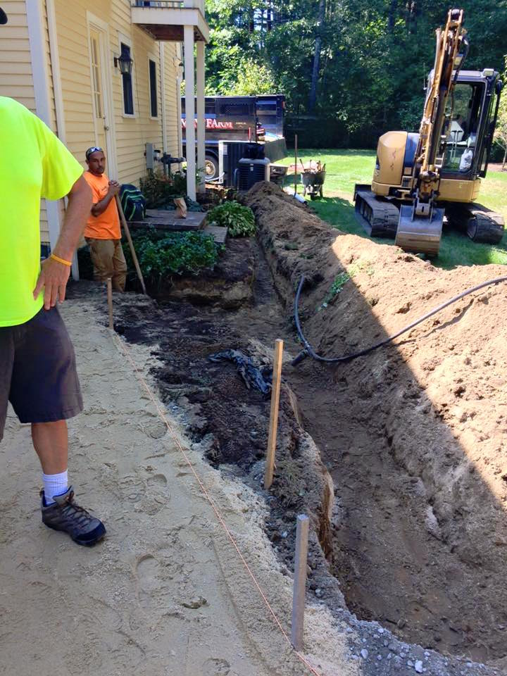 Digging the downspout drainage pipe trench
