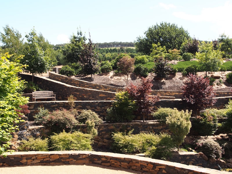 Massive stone walls and wide paths dominate the Mayfield Water Garden