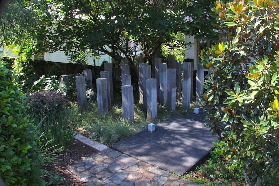 Timber sculpture in garden by Clare James Landscape Design
