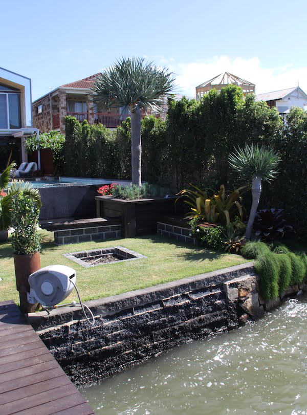 Yards Landscaping - The firepit and lawn area
