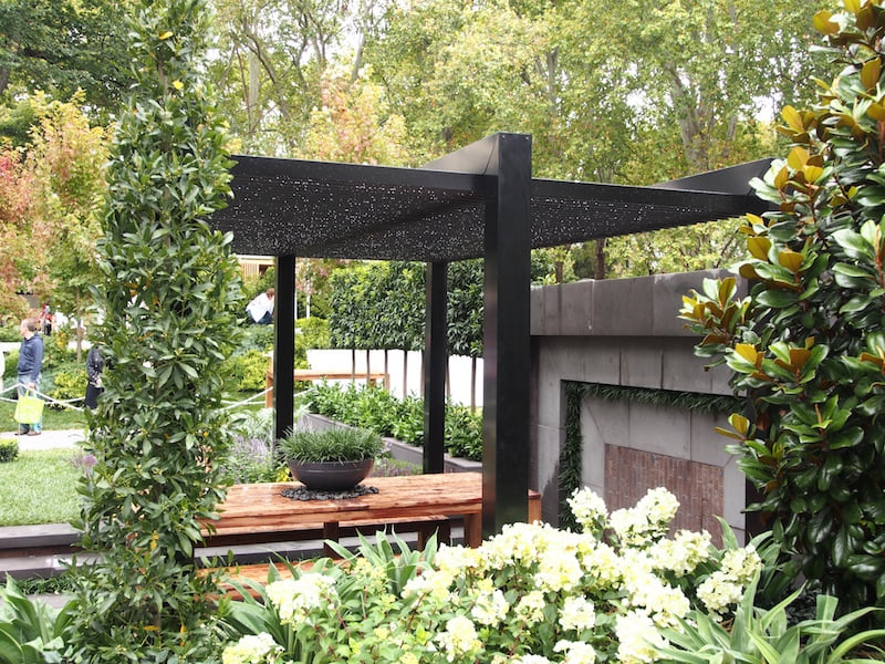 The Greenery Garden by Vivid Design - pergola changes colour to black on the other side
