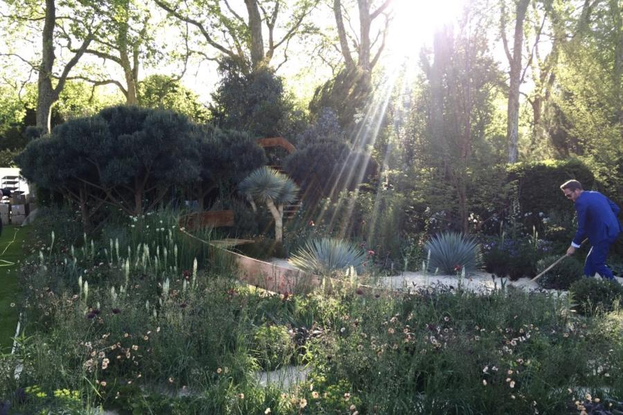 Nick Bailey doing early morning preparations. The Winton Beauty of Mathematics Garden designed by Nick Bailey