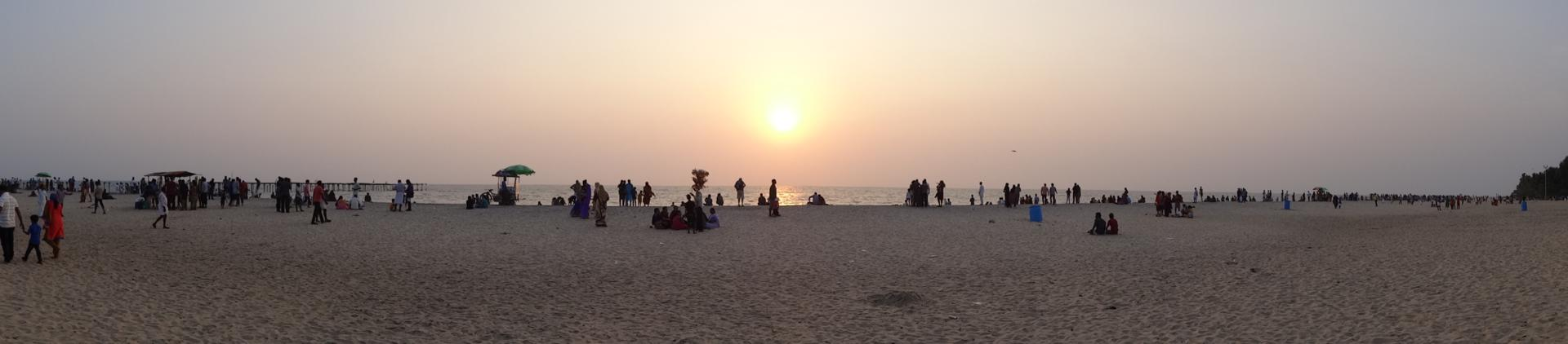 Sunset at Alleppey Beach on the Malabar Coast, Kerala. Locals and tourists gather to watch the setting sun.
