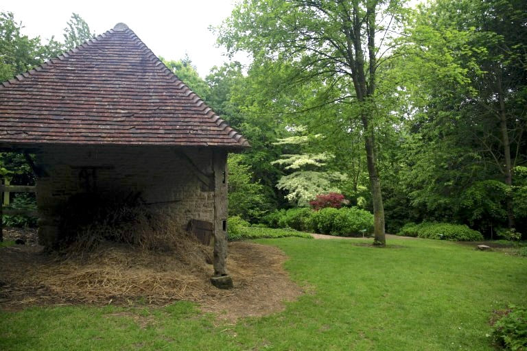 2. Traditional farm buildins among the woodland gardens of Les Jardins en Le Pays d'Auge