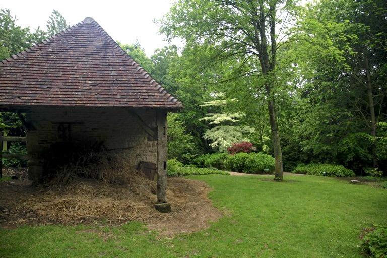 2. Traditional farm buildins among the woodland gardens of Les Jardins en Le Pays d'Auge