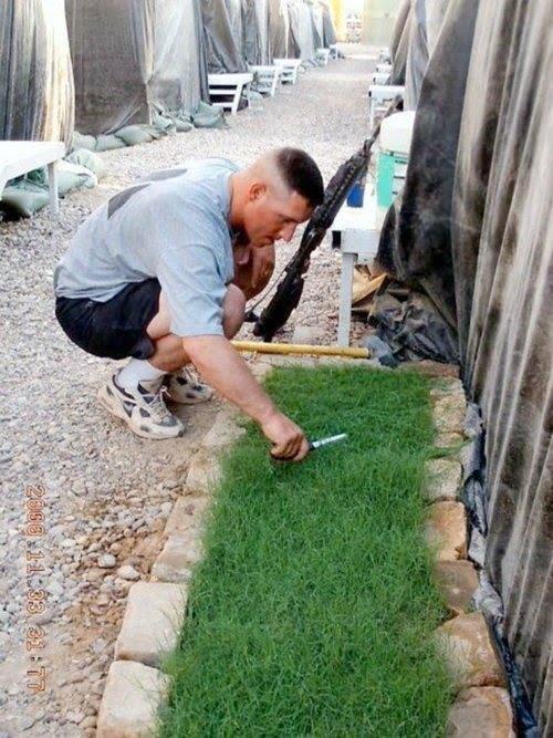 soldier-cutting-grass