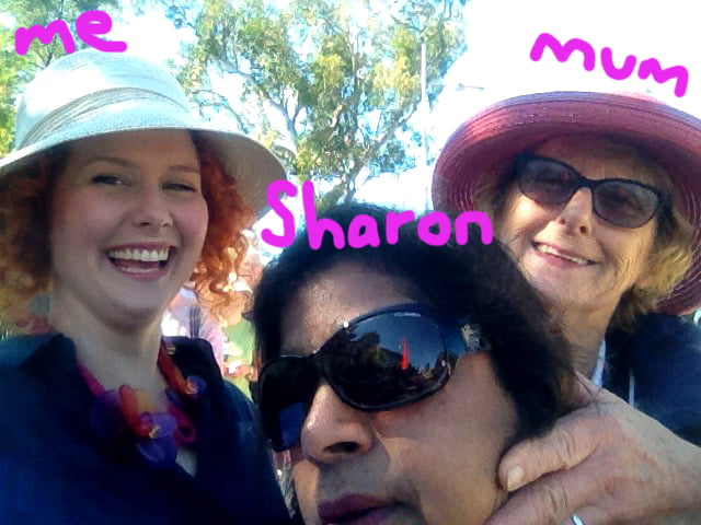 Mum manhandling our friend Sharon into a photo as we stand in line