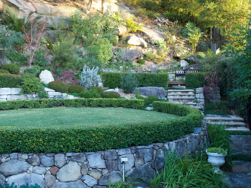 The garden flows from space to space with harmonising sandstone walls and paving.