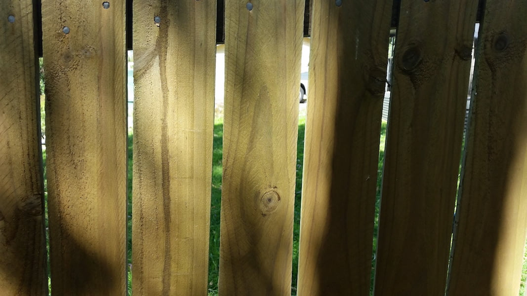 Fences - adjoining timber fence with gaps allows an equalising breeze through